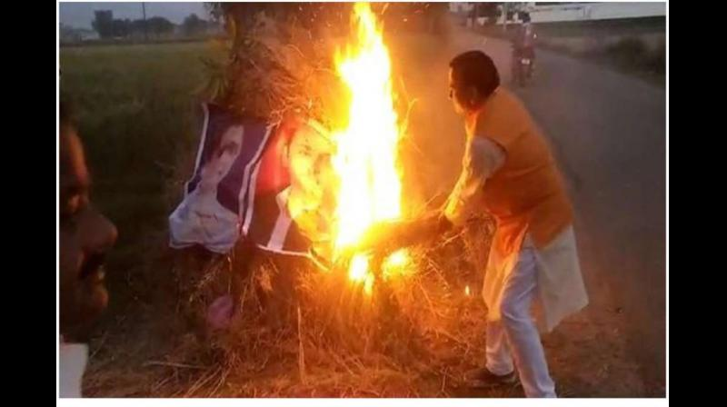 An FIR has been lodged against a senior BJP leader and others on Saturday for allegedly burning posters of BSP Mayawati and SP chief Akhilesh Yadav during 'Holika Dahan' on Wednesday. (Photo: Twitter/ @yadavakhilesh)