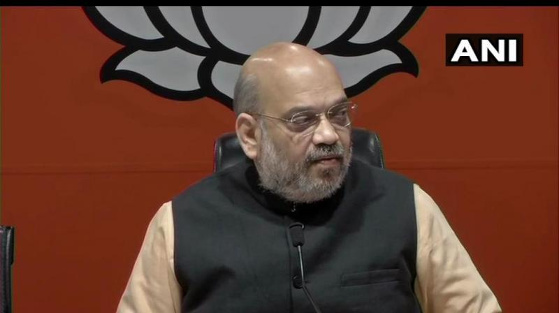 BJP president Amit Shah, who is contesting the Lok Sabha election from Gandhinagar seat in Gujarat, on Sunday embarked on a roadshow in Sanand town. (Photo: File)