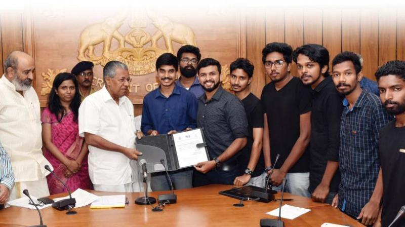 Team GenRobotics with Chief Minister Pinarayi Vijayan after signing the MOU with Kerala Water Authority.