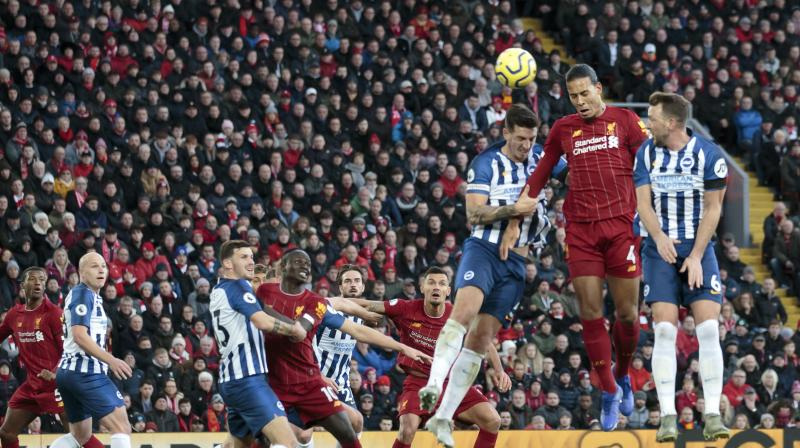 Liverpool hung on after having goalkeeper Alisson Becker sent off to beat Brighton & Hove Albion 2-1 and extend their lead at the top of the Premier League to 11 points thanks to two first-half headers from defender Virgil van Dijk. (Photo:AFP)
