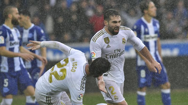 Real Madrid earned a spirited 2-1 win at Alaves on Saturday with a scrappy late goal from defender Dani Carvajal to open up a provisional three-point gap at the top of La Liga. (Photo:AP)