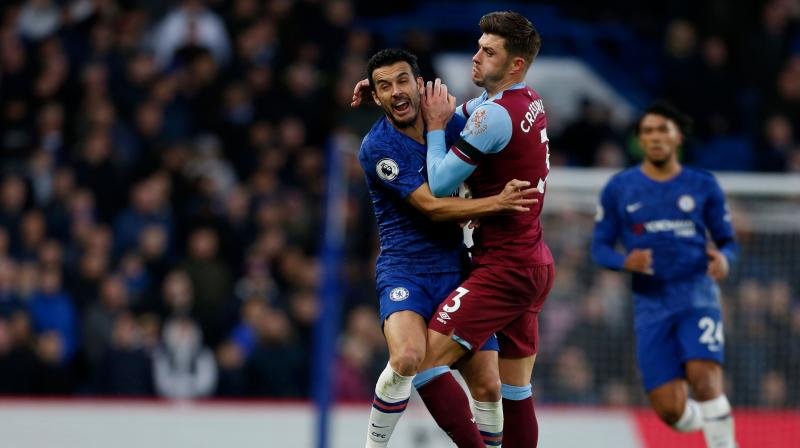 A 48th-minute goal from Aaron Cresswell earned West Ham United a surprise 1-0 victory at Chelsea in the Premier League on Saturday, their first win since September easing pressure on coach Manuel Pellegrini. (Photo:AFP)