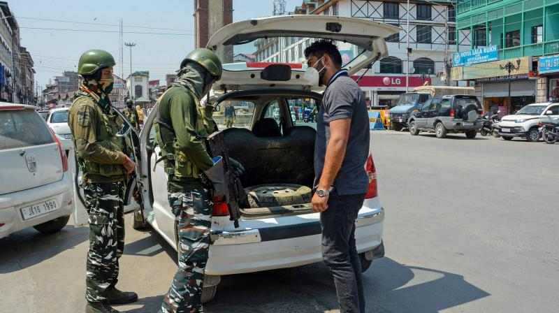 Security personnel conduct a search operation at Lal Chowk Srinagar. — PTI photo