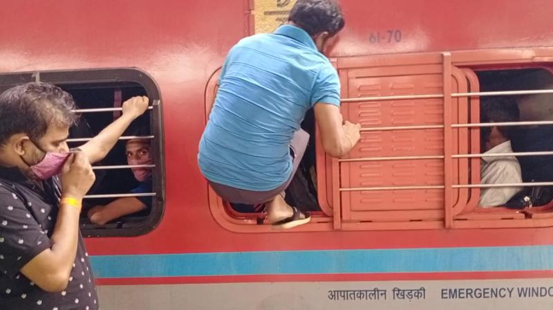 Trains at Mumbai's Lokmanya Tilak Terminus were seen packed with migrant workers as they feared an impending lockdown. (ANI)