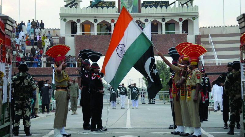 Pakistan Rangers and Indian Border Security Force personnel take part in the daily flag-lowering ceremony at the Wagah-Attari Border. (Photo: PTI)