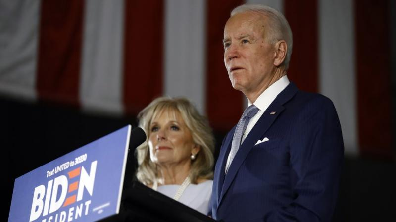 Democratic presidential candidate former Vice President Joe Biden, accompanied by his wife Jill, speaks to members of the press at the National Constitution Center in Philadelphia. AP photo