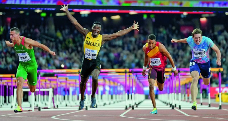 Jamaica's Omar Mcleod (second from left) celebrates winning the men's 110m hurdles at the World Athletics Championships in London on Monday. (Photo: AP)