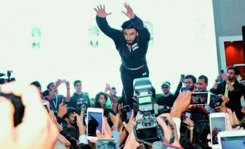 Ranveer Singh attempting a crowd-surf at the Lakme Fashion Week, during the promotional event of his upcoming film Gully Boy.