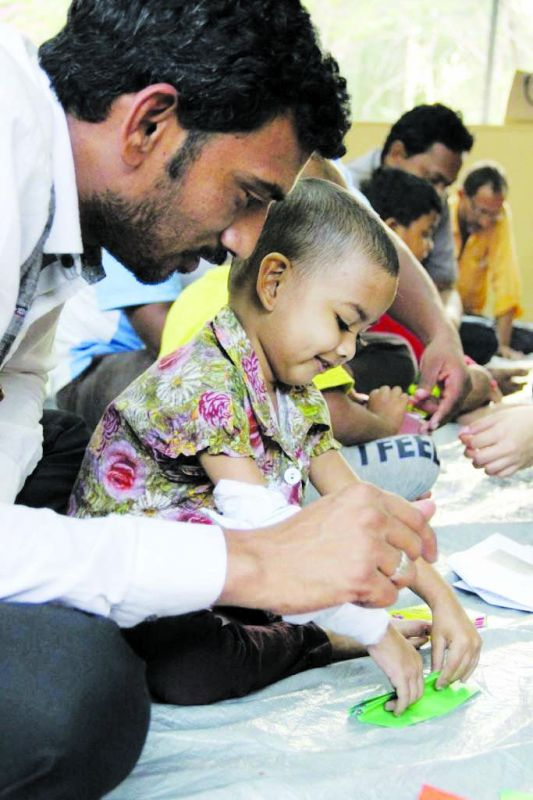 Cancer patients indulging in art therapy