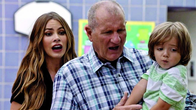A still from the show Modern Family where Ed O'Neill's character Jay Pritchett becomes a father for the third time much later in life.