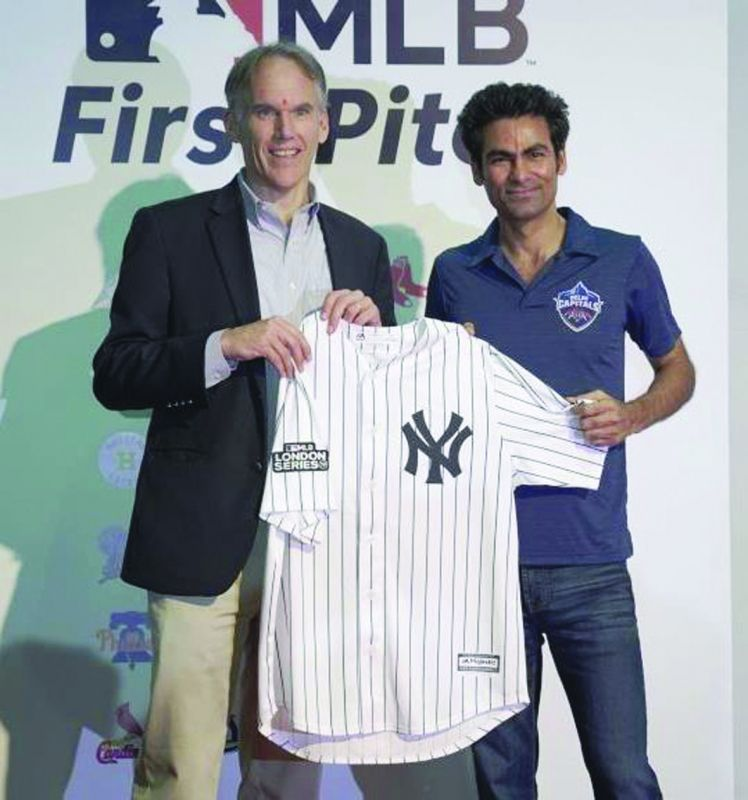 MLB senior vice-president international, Jim Small, exchanges jersey with Mohammad Kaif, the assistant coach of the Delhi Capitals.