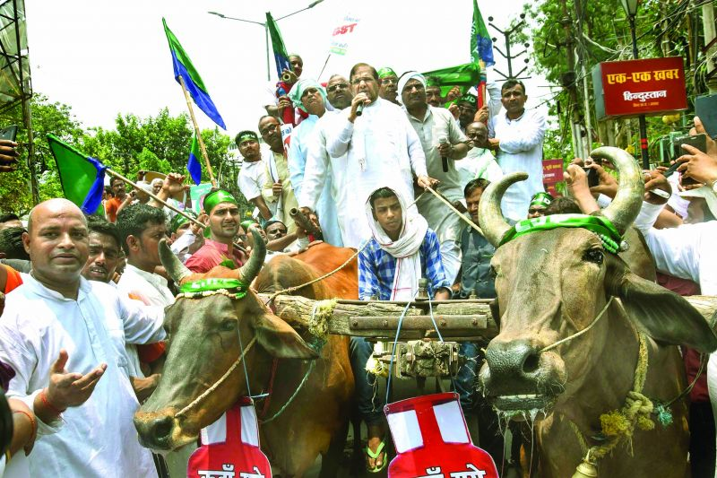 Loktantrik Janata Dal leader Sharad Yadav rides a bullock-cart during a protest against steep hike in fuel prices, in Patna.