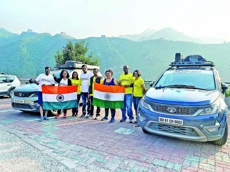 Meenakshi Arvind with her team in front of the Great Wall of China.