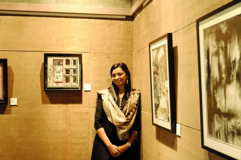 Artist Khushbu Mehta at the gallery space next to her art work.