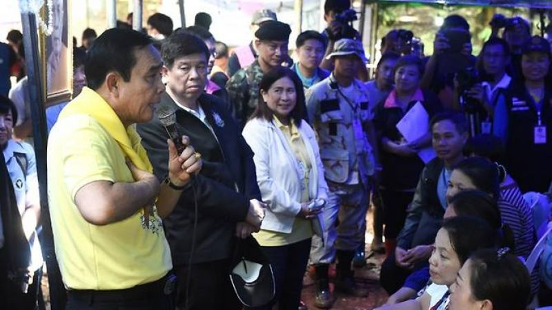 Thai Prime Minister Prayut Chan-O-Cha (L) speaks to family members of missing children and their coach camping out at Khun Nam Nang Non Forest Park in Chiang Rai province on June 29, 2018. (Photo: AFP)