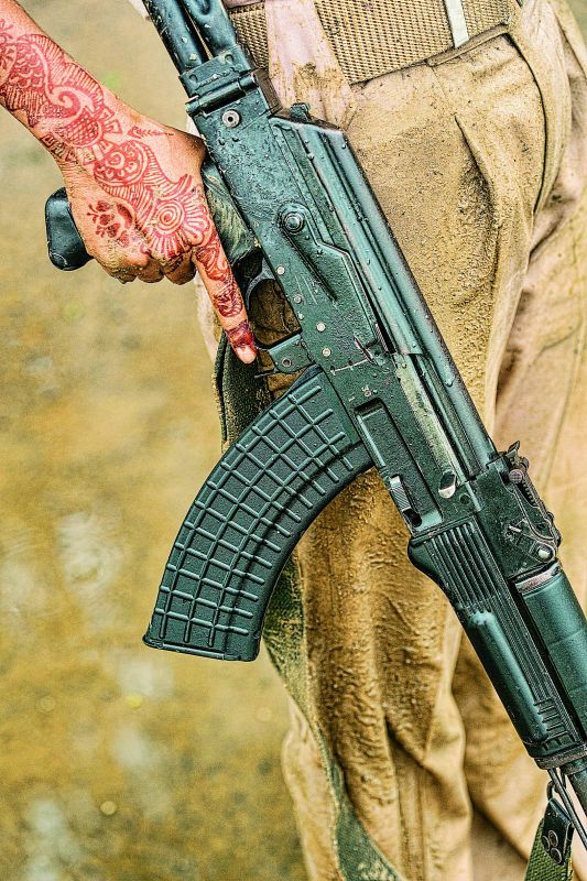 Khaki, mehendi, AK 47, police tribal women battalion Bihar