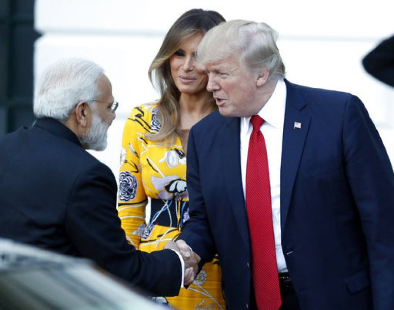 Prime Minister Narendra Modi shakes hands with President Donald Trump, as first lady Melania Trump looks on as Modi departs the White House. (Photo: AP)