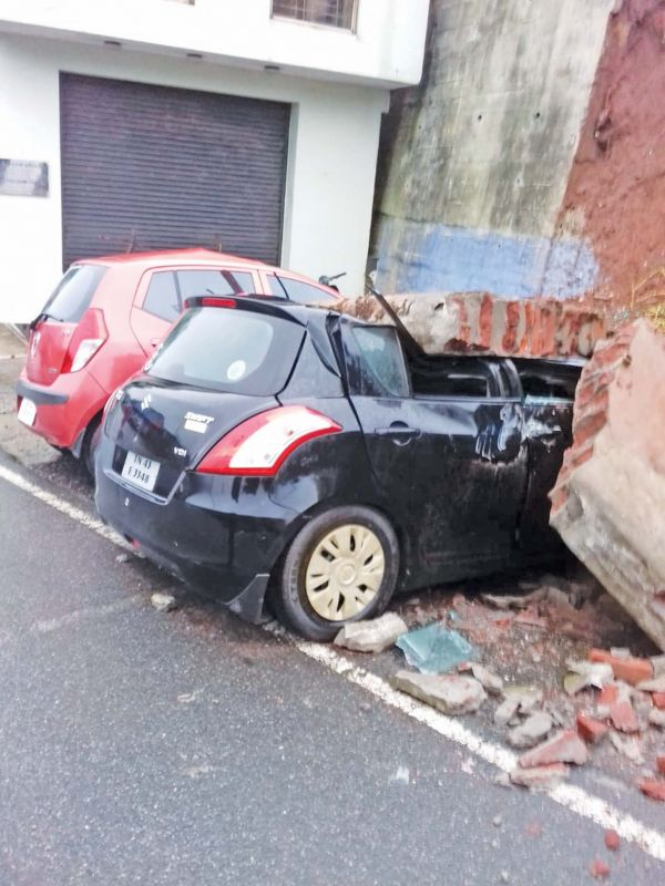 Cars  damaged by wall  collapse in Coonoor.