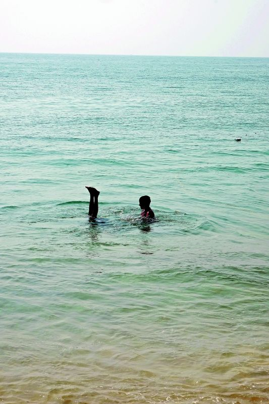 Houdini act: Kids play in the river in Puri