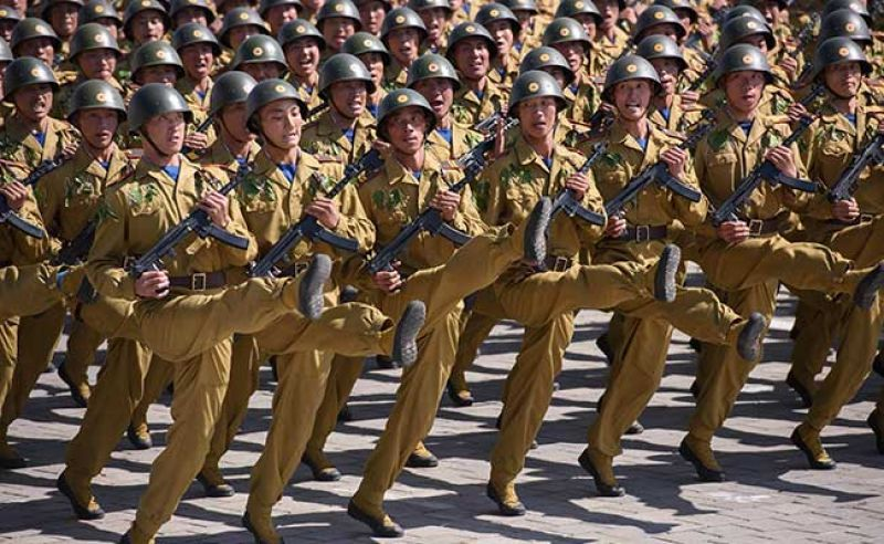 After a 21-gun salute, dozens of infantry units marched through Kim Il Sung Square, some in night-vision goggles or wielding rocket-propelled grenade launchers (AFP)