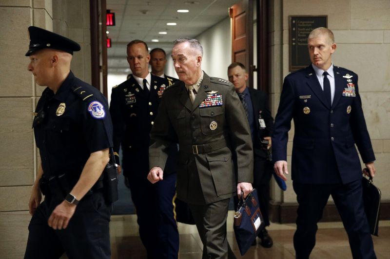 Joint Chiefs Chairman Gen. Joseph Dunford, center, walks to a classified briefing for members of the U.S. Senate on Iran, Tuesday, May 21, 2019, on Capitol Hill in Washington. (AP Photo/Patrick Semansky)