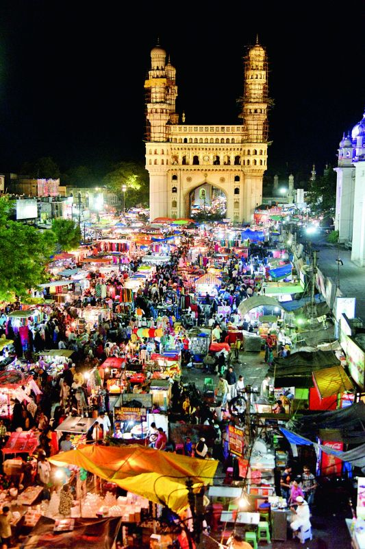 The bustling night market at Charminar.