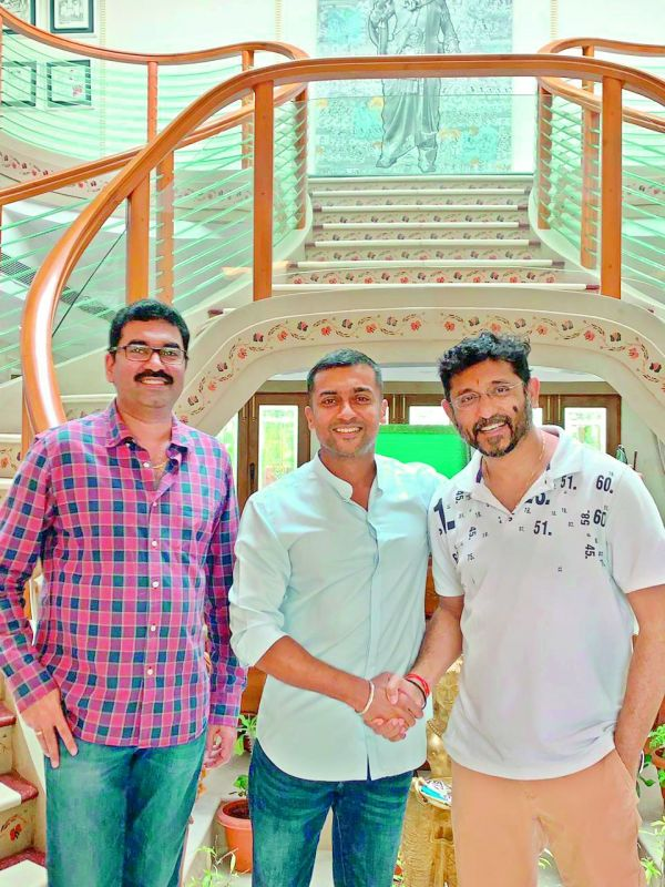 Writers Gopi Mohan (left) and B.V.S. Ravi (right) met actor Suriya at Mohan Babu's house on Monday