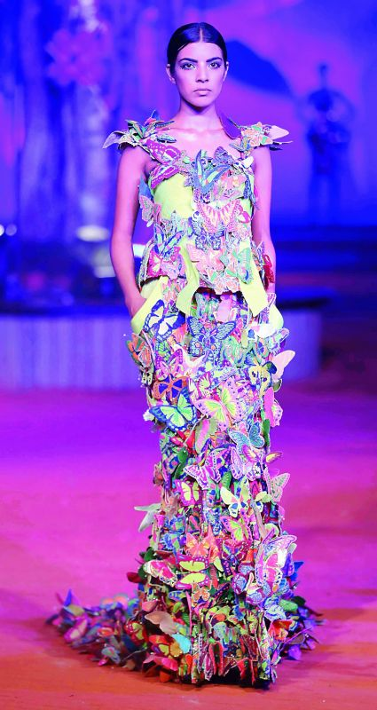Model walking the ramp in a Manish Arora design