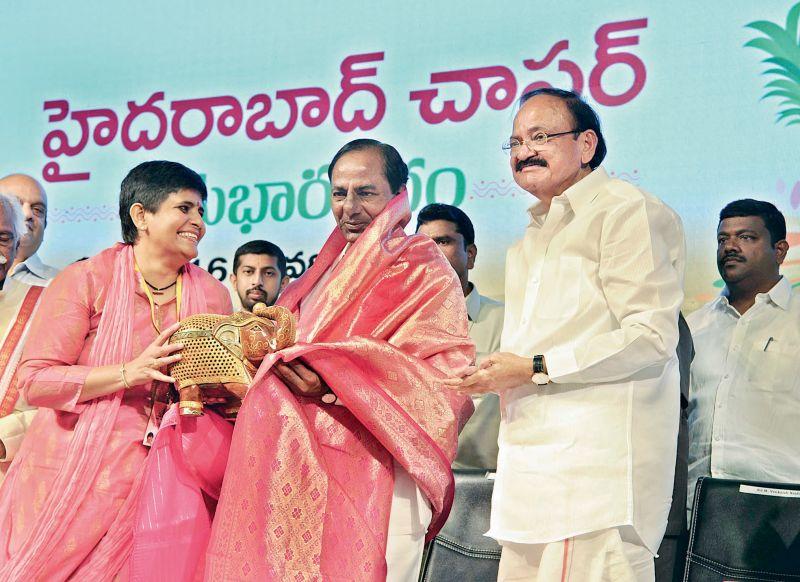 With his daughter Deepa Venkat (managing trustee of Swarna Bharat Trust) and CM K. Chandrasekhar Rao