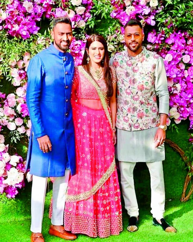 Cricketer Hardik Pandya shared some photos from the Ambani wedding and tagged the designer whose outfit he wore for the event.