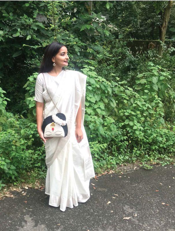 Ela India silver kasavu saree with Subr Studio's Mohini bag