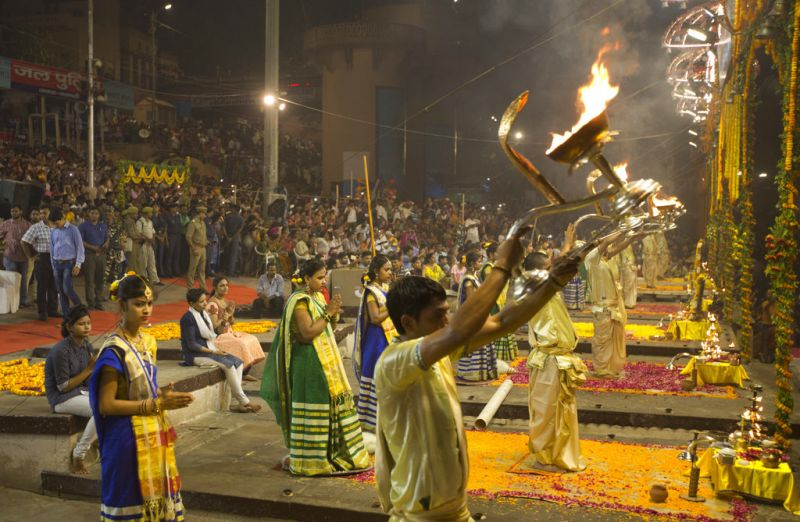 A Hindu priest prays as women devotees stand during Ganga Dussehra festival on the banks of the River Ganges in Varanasi, India, Thursday, May 24, 2018. Hindus across the country celebrate Ganga Dussehra by worshiping the River Ganges, which is considered the most sacred and the holiest river for Hindus. (AP)
