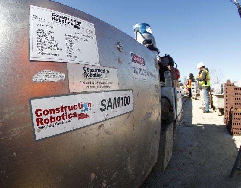 Samantha, a robotic bricklayer, is shown at work.