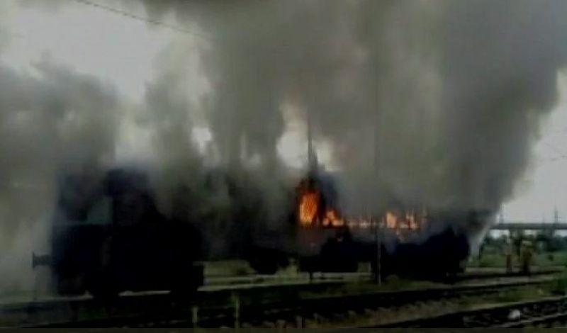 Two empty rakes of Rewa Express at Anand Vihar Terminal railway station set on fire. (Photo: ANI   Twitter)