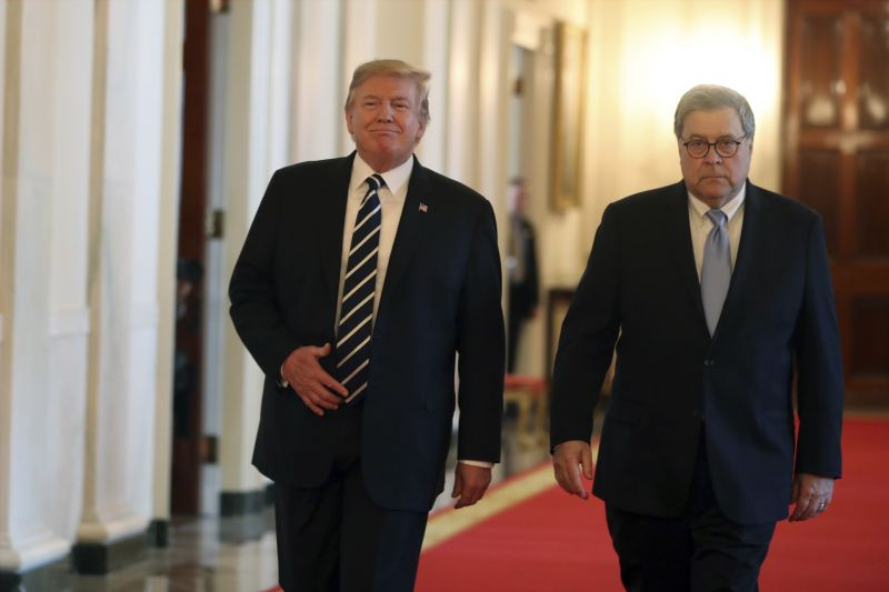 President Donald Trump and Attorney General William Barr arrive for a Public Safety Officer Medal of Valor presentation ceremony in the East Room of the White House, Wednesday, May 22, 2019, in Washington. (AP Photo/Andrew Harnik)