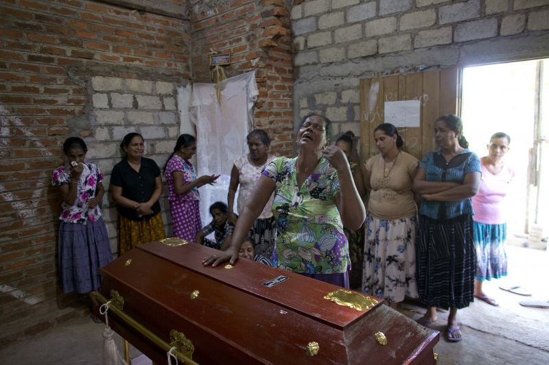 Lalitha, center, weeps standing beside the coffin with the remains of 12-year old niece, Sneha Savindi, who was a victim of Easter Sunday bombing at St. Sebastian Church, in Negombo, Sri Lanka. (Photo:AP)