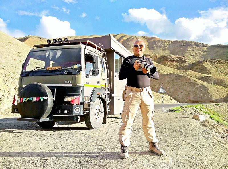 Captain Suresh Sharma beside his truck.