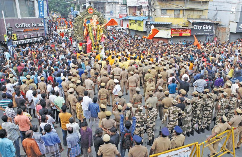 A group of New College Students, Royapettah  garlanded Lord Vinayaga idol kept opposite Royapettah Government hospital Mortuary on Sunday. In an effort to promote communal harmony the  students took part in the puja before the idol was taken for immersion. Senior police officials and local residents also took part in the programme.(Photo: DC)