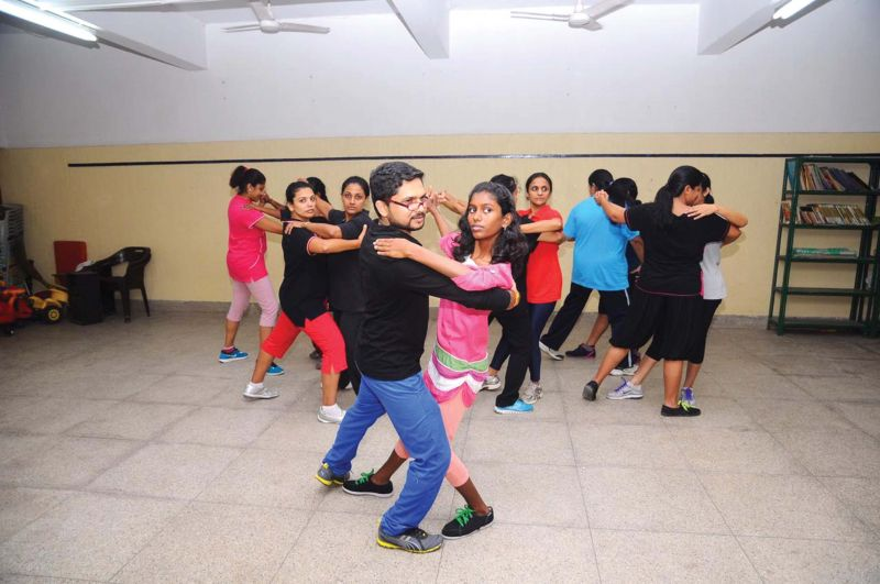 Rajesh Raj  with his students at the Latin dance classes