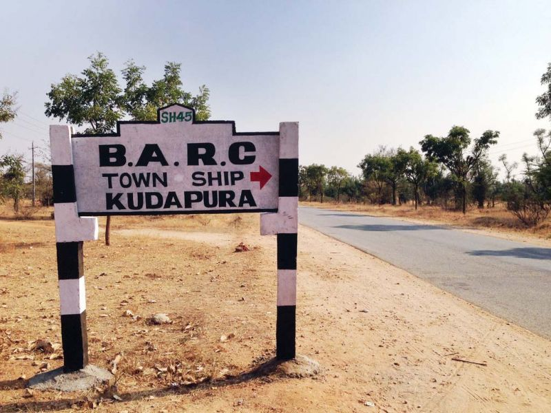 A board indicates the planned BARC facility at Challakere