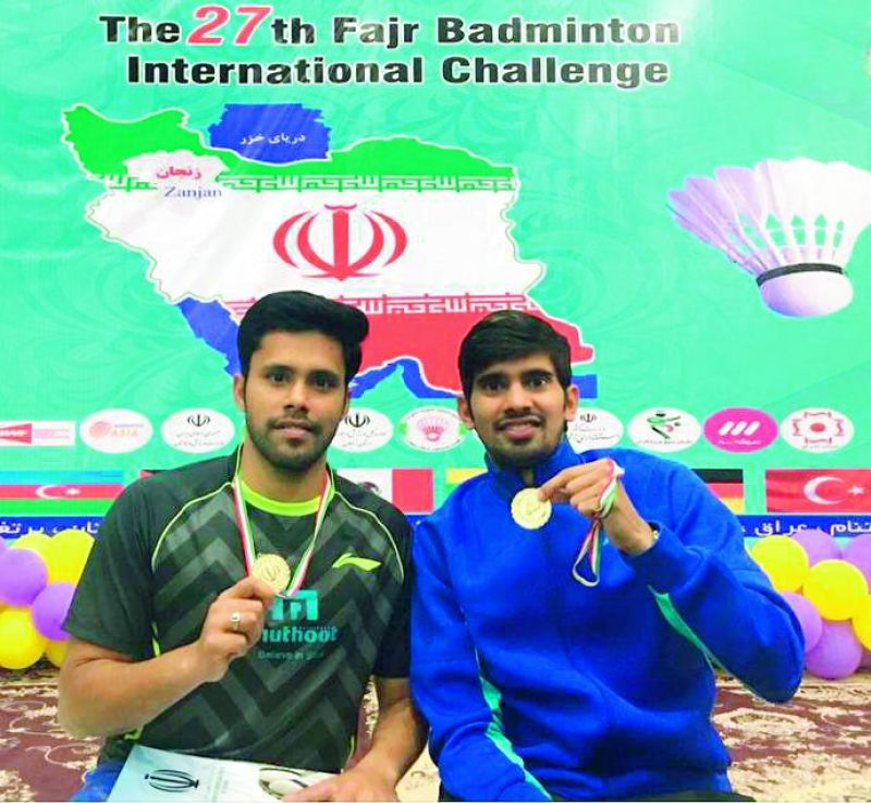 Alwin Francis (left) and Nandagopal Kidambi pose with their medals after winning the Iran Challenger.