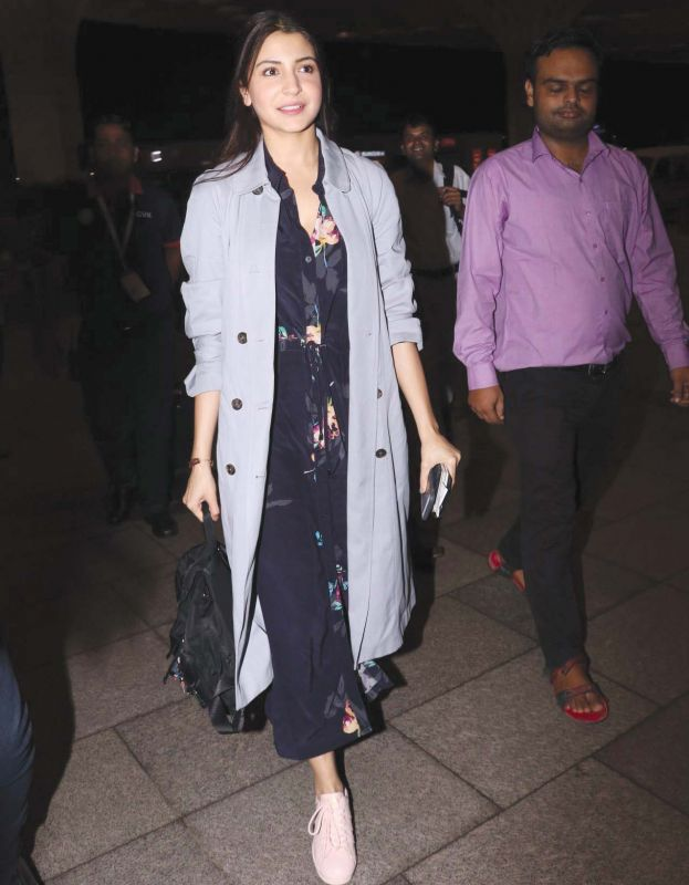 Anushka Sharma has paired her floral dress with an oversized trench coat.