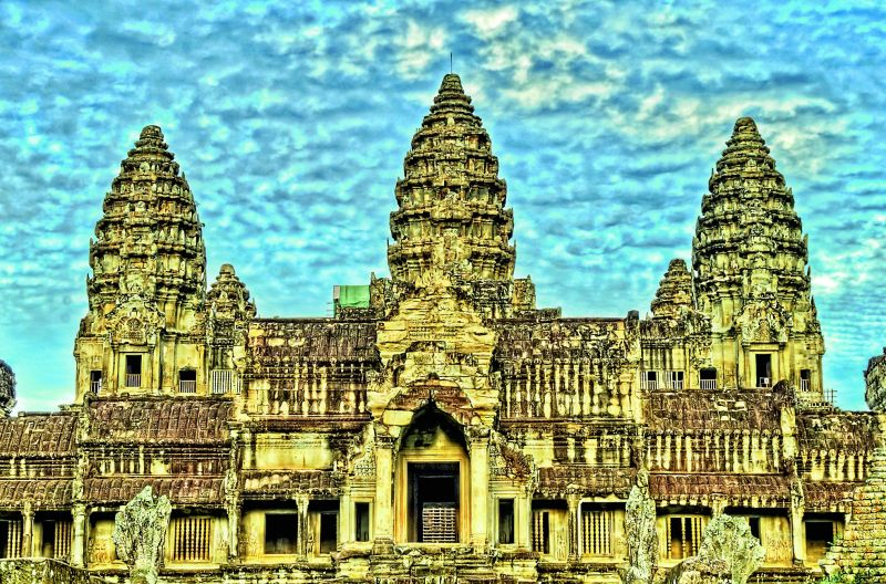 Angkor Wat in Cambodia. Photographed by James Wheeler; (right) Besakih in Bali. Photographed by Anna and Michal (Photo credit: Flickr)