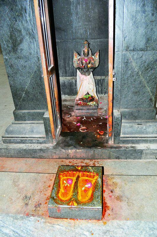 Idol of Rakshapalika garuda with Vishnu Padukas infront infront of him.