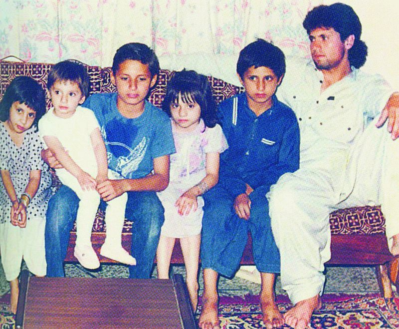 Afridi (fourth from the right) with his siblings