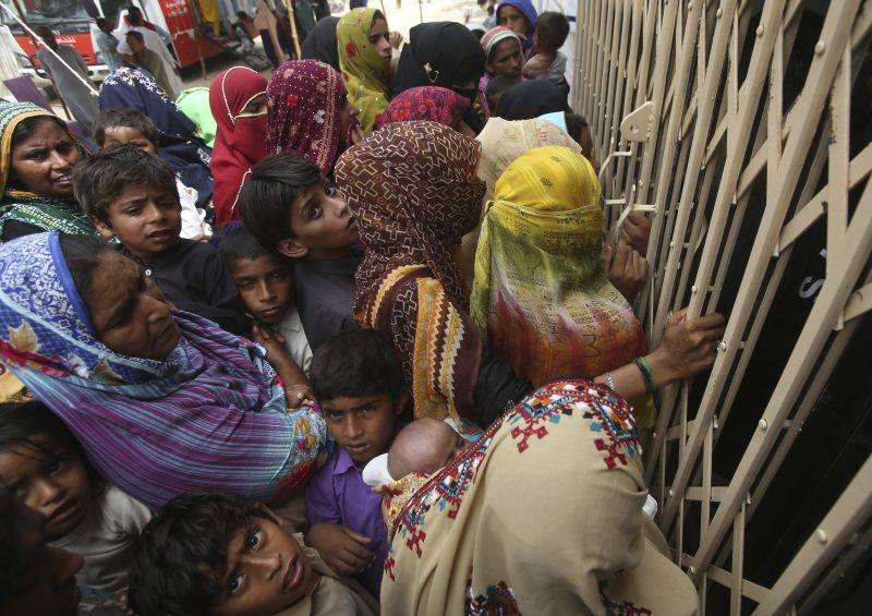 Pakistani villagers wait outside a hospital for blood screening for HIV at a hospital in a village near Ratodero, a small town in southern province of Sindh in Pakistan where the outbreak of deadly disease took place last month, Thursday, May 16, 2019. Officials say about 500 people, mostly children, have tested positive for HIV, the virus that causes AIDS, in a southern Pakistani provincial district. A local doctor who has AIDS has since been arrested and is being investigated for possibly intentionally infecting patients. (AP Photo/Fareed Khan)
