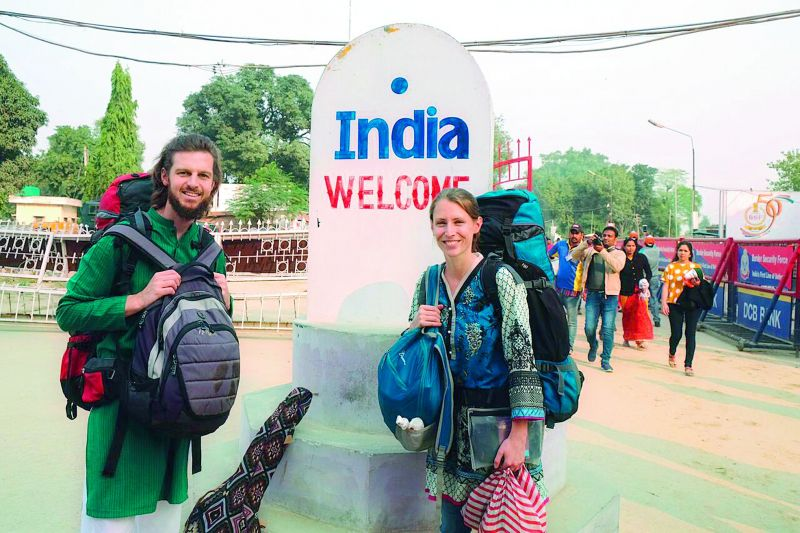 The travel enthusiasts pose for a picture as they enter India