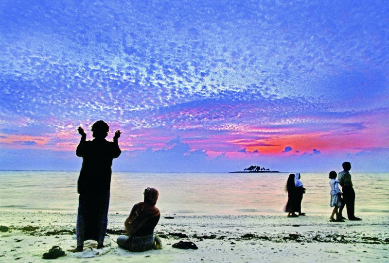 A man offering namaz on the beaches of Minicoy island in Lakshadweep (Photographed in 1999 on film).