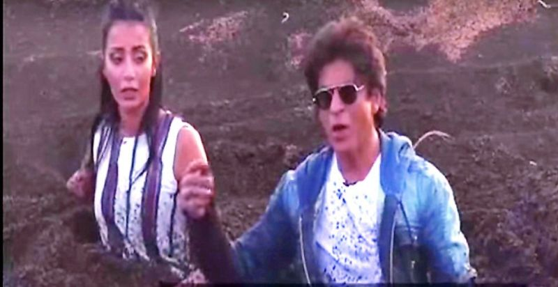 As part of the prank, Shah Rukh fell into a mud pit along with the female host of the show.