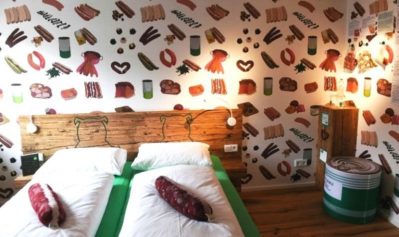 The sausage-themed hotel has opened in Germany to help keep the village butcher's shop alive. (Photo: AFP)